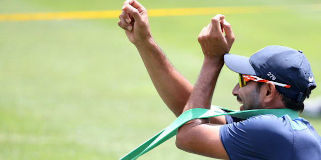 India's Mohammed Shami uses a rubber band to stretch out during training for their cricket test match against Australia in Sydney, Sunday, Jan. 4, 2015. Their final test of the series  begins on Jan. 6 with Australia leading the series 2-0. (AP Photo/Rick Rycroft)
