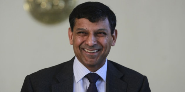 """Reserve Bank of India (RBI) Governor Raghuram Rajan smiles after announcing the first bimonthly monetary policy statement at the RBI headquarters in Mumbai, India, Tuesday, April 1, 2014. Rajan announced Tuesday that the key policy rate will remain unchanged since retail inflation still remains """"sticky"""" but introduced steps to increase liquidity and contain volatility in the money market, according to a local news agency. (AP Photo/Rafiq Maqbool)"""
