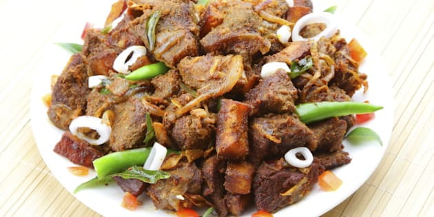 Indian meat fry served on plate.