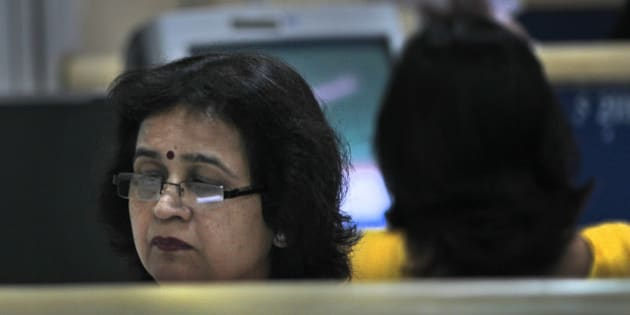 An Indian woman works in an office in New Delhi, India, Thursday, April 19, 2012. The 2 billion women living in Asia are still paid less than men for similar work and are extremely underrepresented in top leadership positions, even in wealthy countries such as Japan, the Asia Society says in a report issued Thursday. (AP Photo/Manish Swarup)