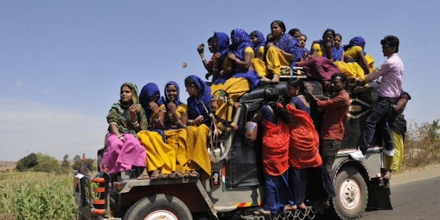 ALIRAJPUR, INDIA - MARCH 2: Young tribal women travelling on a overloaded jeep to go to the Bhagoria tribal festival also known as Bhagoria Haat Festival on March 2, 2015 in Alirajpur, India. Bhagoria is a festival celebrated by the Bhils and Bhilalas tribes of Malwa region of the Indian state Madhya Pradesh. Bhagoriya is a local phrase for elopers. During this festival, young boys and girls are allowed to elope after choosing their partners before marrying formally. (Photo by Praveen Bajpai/Hindustan Times via Getty Images)