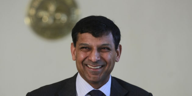 "Reserve Bank of India (RBI) Governor Raghuram Rajan smiles after announcing the first bimonthly monetary policy statement at the RBI headquarters in Mumbai, India, Tuesday, April 1, 2014. Rajan announced Tuesday that the key policy rate will remain unchanged since retail inflation still remains ""sticky"" but introduced steps to increase liquidity and contain volatility in the money market, according to a local news agency. (AP Photo/Rafiq Maqbool)"