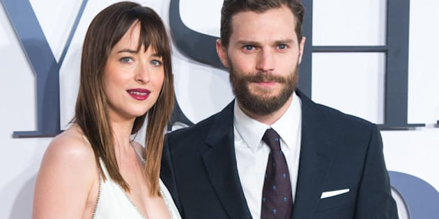 LONDON, ENGLAND - FEBRUARY 12:  Jamie Dornan and Dakota Johnson attend the UK Premiere of 'Fifty Shades Of Grey' at Odeon Leicester Square on February 12, 2015 in London, England.  (Photo by Samir Hussein/WireImage)