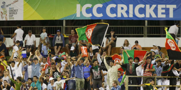 Cricket fans from Afghanistan wave their national flag and cheer for their team during the Cricket World Cup Pool A match between Afghanistan and Australia in Perth, Australia, Wednesday, March 4, 2015. (AP Photo Theron Kirkman)