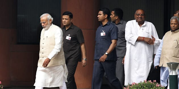 NEW DELHI, INDIA - FEBRUARY 24: Prime Minister Narendra Modi after BJP Parliamentary party meeting at Parliament House on February 24, 2015 in New Delhi, India. The government introduced the land acquisition amendment bill in the Lok Sabha amid an uproar by the opposition. (Photo by Arvind Yadav/Hindustan Times via Getty Images)