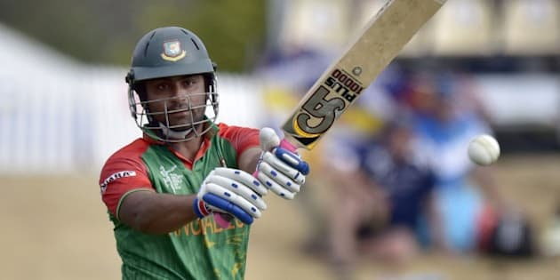Bangladesh batsman Tamim Iqbal plays a shot during the Pool A 2015 Cricket World Cup match between Bangladesh and Scotland at Saxton Park Oval in Nelson on March 5, 2015.  AFP PHOTO / MARTY MELVILLE        (Photo credit should read Marty Melville/AFP/Getty Images)