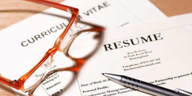 CV and resume with glasses and pen.