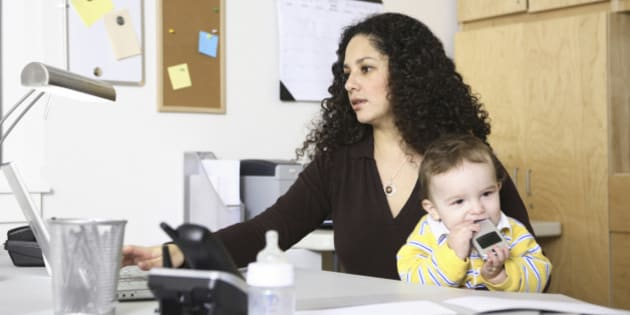 Woman in home office with child