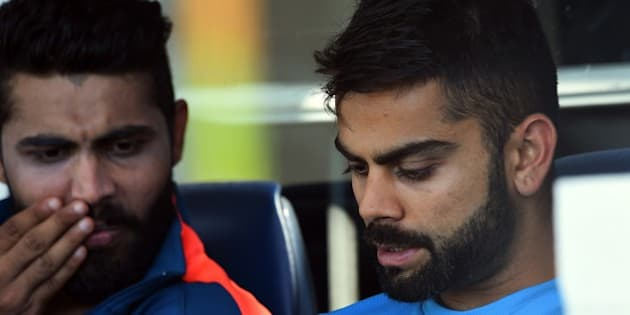 India's Virat Kohli (R) and Ravindra Jadeja (L) relax after completing a final training session ahead of the 2015 Cricket World Cup Pool B match between the West Indies and India in Perth on March 5, 2015.    AFP PHOTO / Greg WOOD --IMAGE RESTRICTED TO EDITORIAL USE - STRICTLY NO COMMERCIAL USE--        (Photo credit should read GREG WOOD/AFP/Getty Images)