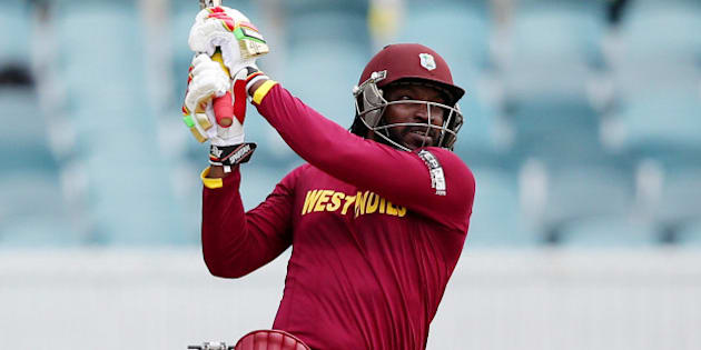 West Indies batsman Chris Gayle hits the ball to the boundary during their Cricket World Cup Pool B match against Zimbabwe in Canberra, Australia, Tuesday, Feb. 24, 2015. (AP Photo/Rob Griffith)