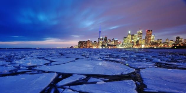 Toronto harbour in winter with ice chunks.