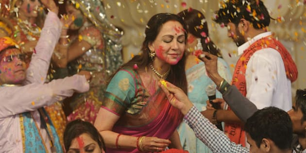 NEW DELHI, INDIA - MARCH 5: Bollywood actress and BJP MP from Mathura, Hema Malini takes part in the Holi celebration programme at CGA ground near Karkardooma Court on March 5, 2015 in New Delhi, India. (Photo by Sushil Kumar/Hindustan Times via Getty Images)