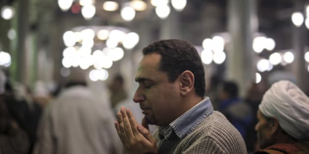 A man prays as Egyptian Muslims gather during Moulid al-Hussein, a religious celebration marking the birthday of the grandson of the Prophet Muhammad, in Cairo, Egypt, Tuesday, Feb. 17, 2015. The celebration is one of the largest in Egypt, which attracts hundreds of thousands of Muslims worshippers from all over the country and takes place at Al-Hussein mosque. (AP Photo/Mosa'ab Elshamy)