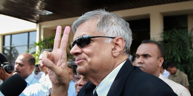 COLOMBO - SRI LANKA - JANUARY 09: Sri Lanka's newly elected Prime Minister Ranil Wickremasinghe flashes v-sign arrives at the election commission office in Colombo, Sri Lanka, on January 09, 2015.   (Photo by Chamila Karunarathne/Anadolu Agency/Getty Images)
