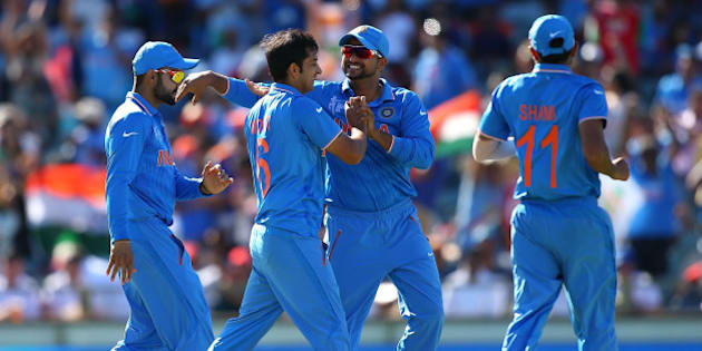 PERTH, AUSTRALIA - MARCH 06: Mohit Sharma and Virat Kohli of India celebrate a wicket during the 2015 ICC Cricket World Cup match between India and the West Indies at WACA on March 6, 2015 in Perth, Australia.  (Photo by Paul Kane/Getty Images)