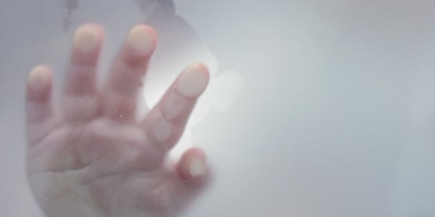 Hand of a 17 month old boy touching glass