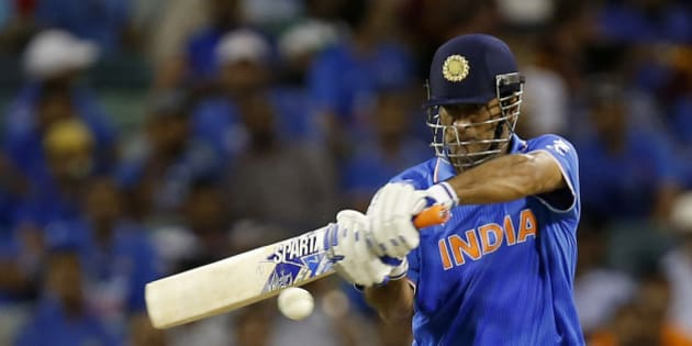 Indian batsman M S Dhoni plays a shot during their Cricket World Cup Pool B match against the West Indies in Perth, Australia, Friday, March 6, 2015. (AP Photo/Theron Kirkman)