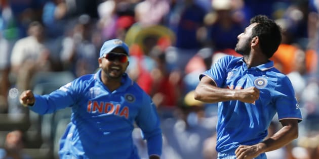 India's Mohammed Shami, right, celebrates with his teammate M S Dhoni after dismissing West Indies batsman Dwayne Smith during their Cricket World Cup Pool B match in Perth, Australia, Friday, March 6, 2015. (AP Photo Theron Kirkman)