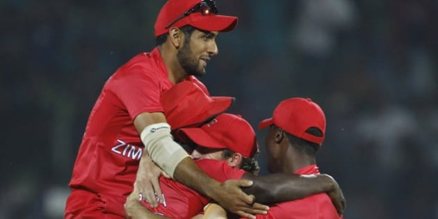 Zimbabwe's players celebrate the wicket of Ireland's Max Sorensen during their ICC Twenty20 Cricket World Cup match in Sylhet, Bangladesh, Monday, March 17, 2014. (AP Photo/A.M. Ahad)
