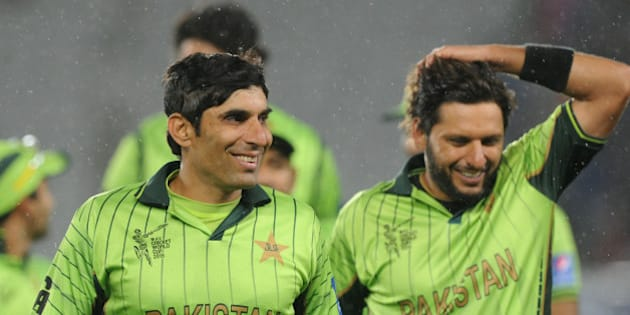 Pakistan's captain Misbah Ul Haq, left, and teammate Shahid Afridi smile as they leave the field after their 29 run win over South Africa in their Cricket World Cup Pool B match in Auckland, New Zealand, Saturday, March 7, 2015. (AP Photo/Ross Setford)