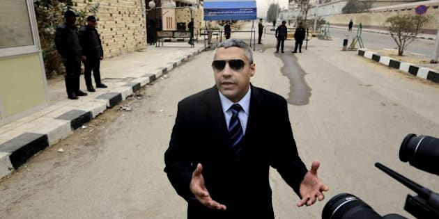 Canadian Al-Jazeera English journalist Mohamed Fahmy, speaks to the media outside a court before his retrial in Cairo, Egypt, Monday, Feb. 23, 2015. The retrial of two Al-Jazeera English journalists who face terror-related charges in a case widely criticized by human rights organizations and media groups has been postponed to March 8. (AP Photo/Amr Nabil)