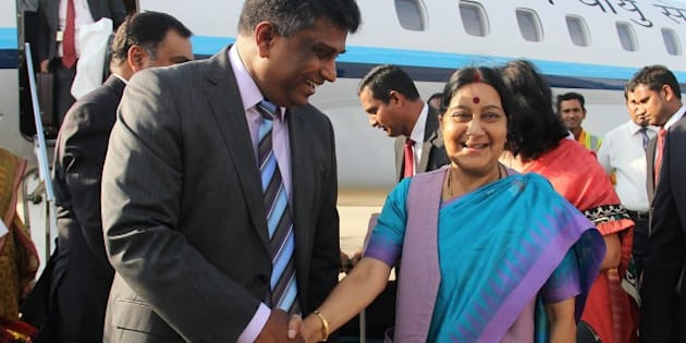 Indian Foreign Minister Sushma Swaraj (R) shakes hands with Sri Lankan Deputy Foreign Minister Ajith P. Perera (L) upon her arrival at the Bandaranaike International Airport in Katunayake on March 6, 2015. Swaraj is in Sri Lanka for talks ahead of Indian Prime Minister Narendra Modis visit from March 13-14. AFP PHOTO / ISHARA S. KODIKARA        (Photo credit should read Ishara S.KODIKARA/AFP/Getty Images)