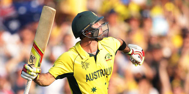 Australia's Glenn Maxwell celebrates after scoring  a century while batting against Sri Lanka during their Cricket World Cup Pool A match in Sydney, Australia, Sunday, March 8, 2015. (AP Photo/Rob Griffith)
