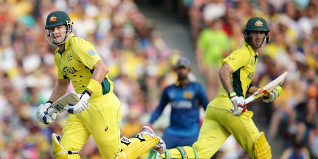 Australian batsmen Shane Watson, left and Glenn Maxwell run while batting against Sri Lanka during their Cricket World Cup Pool A match in Sydney, Australia, Sunday, March 8, 2015. (AP Photo/Rob Griffith)