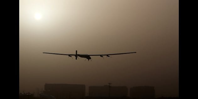 The Solar Impulse 2, takes off from al-Bateen airport in Abu Dhabi as it heads to Muscat, on March 9, 2015, in the first attempt to fly around the world in a plane using solar energy. The first attempt to fly around the world in a plane using only solar power launched on March 9 in Abu Dhabi in a landmark journey aimed at promoting green energy.  AFP PHOTO / MARWAN NAAMANI        (Photo credit should read MARWAN NAAMANI/AFP/Getty Images)