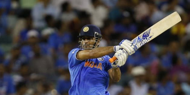 Indian batsman M S Dhoni watches his shot during their Cricket World Cup Pool B match against the West Indies in Perth, Australia, Friday, March 6, 2015. (AP Photo/Theron Kirkman)