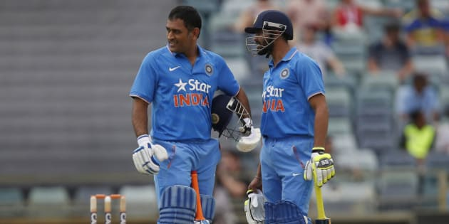 India's MS Dhoni, left, and team mate Ravindra Jadeja speak during their one-day international cricket match against England in Perth, Australia, Friday, Jan. 30, 2015. (AP Photo/Theron Kirkman)