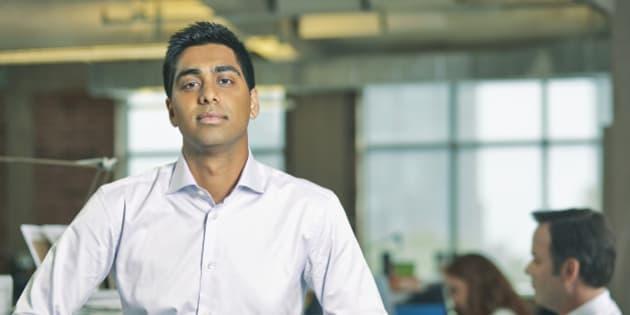 Portrait of man standing in office
