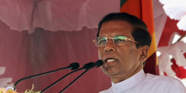 Sri Lanka's new President Maithripala Sirisena addresses the nation outside the Temple of Tooth in Kandy, Sri Lanka, Sunday, Jan. 11, 2015. Sirisena, a longtime political inside, and an ally of former President Mahinda Rajapaksa until just a few weeks ago, won the Thursday election by capitalizing on Rajapaksa's unpopularity among this island nation's ethnic and religious minorities, as well as grumbling among the Sinhalese majority about his family's growing power. Sri Lanka's new government will investigate an alleged attempt by Rajapaksa to stage a coup to try to stay in power when results showed he was losing last week's election, a spokesman for the country's new leader said Sunday. (AP Photo/Sanka Gayashan)
