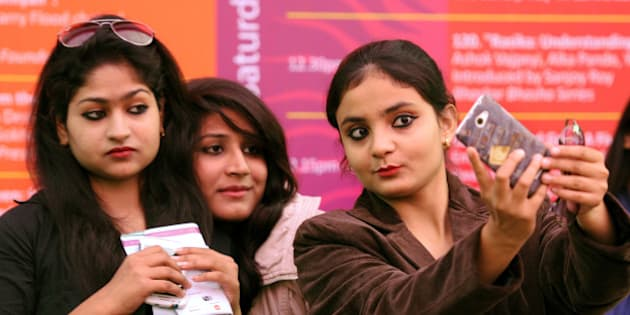 JAIPUR, INDIA - JANUARY 23: Visitors take selfies at the Jaipur Literature festival at Diggi Palace on January 23, 2015 in Jaipur, India. One of the largest literary festival on earth, the Jaipur Literature Festival brings together some of the greatest thinkers and writers from across South Asia and the world. (Photo by Mohd Zakir/Hindustan Times via Getty Images)