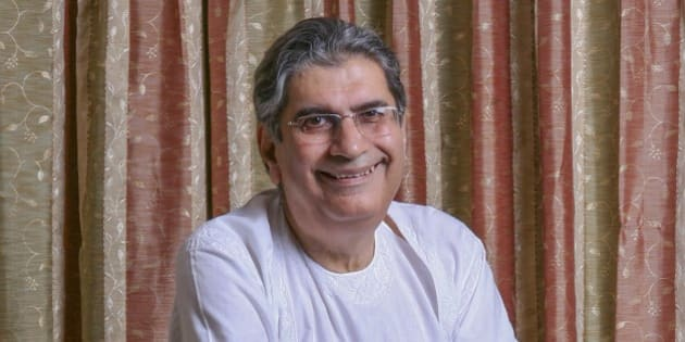 In this Aug.5, 2011 photo provided by India's Outlook Magazine, journalist and author Vinod Mehta poses for a portrait at his home in New Delhi, India. Mehta, founding editor of India's Outlook magazine and a fearless and irreverent commentator on Indian politics, died Sunday. He was 73. (AP Photo/Narendra Bisht, Outlook Magazine)
