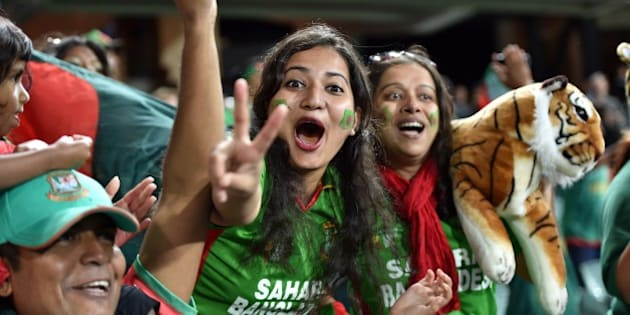 Bangladeshi fans celebrate their team's victory in the 2015 Cricket World Cup Pool A match between Bangladesh and England at the Adelaide Oval on March 9, 2015. AFP PHOTO / Saeed KHAN