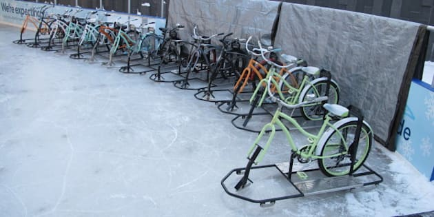 A line of ice bikes await riders at the Ice at Canalside in Buffalo, N.Y., Feb. 25, 2015. Since the rental bikes debuted in December, Ice Bikes of Buffalo founder Lisa Florczak has gotten inquiries from other cold-weather cities interested in rolling them out next year. (AP Photo/Carolyn Thompson)