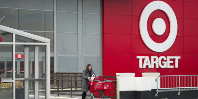 Shopper Laura Steele pushes a shopping cart as she leaves a Target Corp. store in Toronto, Ontario, Canada, on Thursday, Jan. 15, 2015. Target Corp. will walk away from Canada less than two years after opening stores there, putting an end to a mismanaged expansion that racked up billions in losses. Photographer: Kevin Van Paassen/Bloomberg via Getty Images