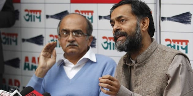 NEW DELHI, INDIA - DECEMBER 18: Aam Aadmi Party leaders Yogendra Yadav (R) with Prashant Bhushan during a press conference at North Avenue, on December 18, 2014 in New Delhi, India. Party expected more than 5,000 volunteers to arrive in Delhi for the 2015 Delhi assembly elections. (Photo by Arvind Yadav/Hindustan Times via Getty Images)