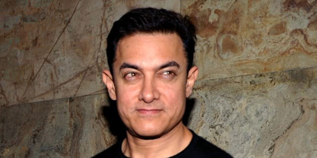 Indian Bollywood actor Aamir Khan  attends a special screening of Hindi film 'PK' in Mumbai on December 25, 2014.  AFP PHOTO/STR        (Photo credit should read STRDEL/AFP/Getty Images)