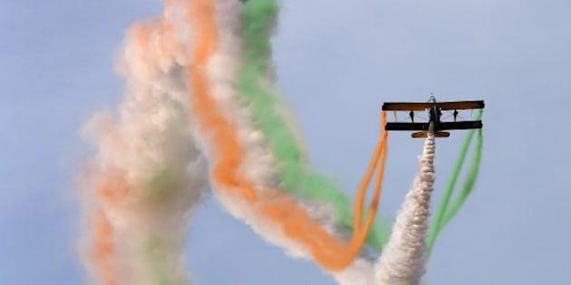 Catwalk or Skycats of the Scandinavian Aerobatic Team leave a trail of Indian tri-colour smoke as they perform aerobatics during the second day of the Aero India 2015 at the Yelahanka Airforce Station in Bangalore on February 19, 2015.    AFP PHOTO / Manjunath KIRAN        (Photo credit should read Manjunath Kiran/AFP/Getty Images)