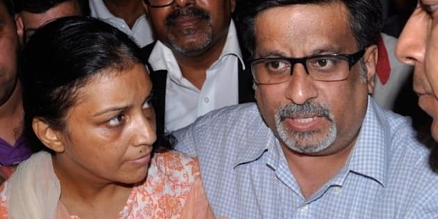 'GHAZIABAD, INDIA - SEPTEMBER 25: Dentist Nupur Talwar, facing trial in the twin murder case of her daughter Aarushi and domestic aide Hemraj, was today ordered by a CBI court to be released from prison on bail on September 25, 2012 in Ghaziabad, India. Her husband Rajesh Talwar also present there with her.( Photo by Sakib Ali/Hindustan Times via Getty Images)'
