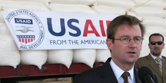 Amman, JORDAN:  US ambassador to Jordan David Hale speaks to reporters in front of bags of wheat in Amman 31 August 2006 before they are sent to Lebanon. The US government today donated 700 tonnes of wheat to Lebanon as part of a 'goodwill' gesture to help relief efforts, with the first trucks heading for Beirut from Jordan, the US embassy said. The wheat, which was milled into flower at Jordan's South Amman Mills, is expected to help feed 350,000 people in Lebanon, Hale said. Six trucks were heading to Lebanon, via Syria, today while 12 others will follow in the next couple of days, the embassy said. AFP PHOTO/KHALIL MAZRAAWI  (Photo credit should read KHALIL MAZRAAWI/AFP/Getty Images)