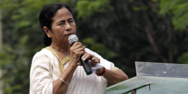 West Bengal state Chief Minister and Trinamul Congress leader Mamata Banerjee addresses a rally of students and youth in Kolkata, India, Tuesday, Aug. 27, 2013. (AP Photo/Bikas Das)