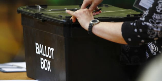 File photo dated 28/02/13 of a ballot box being opened, as a parliamentary committee has said that the Government should bring forward legislation to allow some prisoners to vote to keep in line with human rights laws.