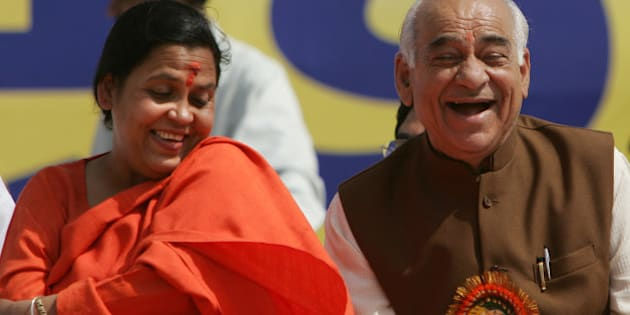 Uma Bharti, left, and Madan Lal Khurana share a light moment at a rally in New Delhi, India, Tuesday March 21, 2006. Uma Bharti declared her intentions of launching a new party while addressing her supporters at the rally. (AP Photo/Saurabh Das)