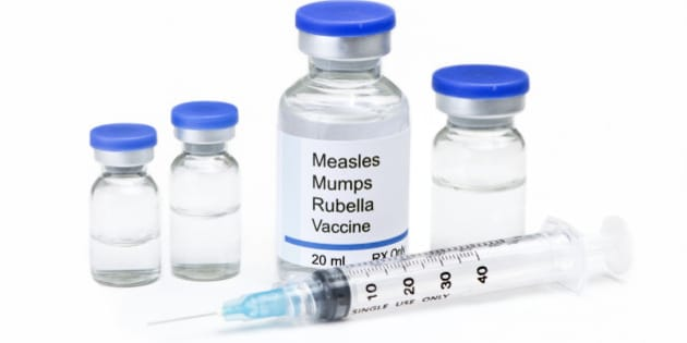 Measles, mumps, rubella, virus vaccine vials and syringe on white background.  Label is fictitious, and any resemblance to any actual product is purely coincidental.