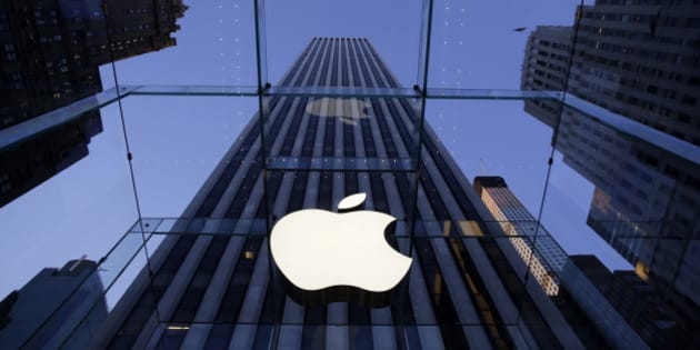 In this Sept. 5, 2014 photo, the Apple logo hangs in the glass box entrance to the company's Fifth Avenue store, in New York. Apple on Wednesday, Oct. 8, 2014 sent invites to an Oct. 16 event during which it's expected to show off new models of its popular iPad and an update to its Mac OS system.(AP Photo/Mark Lennihan)