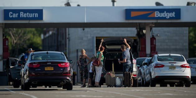 Customers return a rental car to the Avis Budget Group Inc. location for LaGuardia Airport (LGA) in the Queens borough of New York, U.S., on Monday, Aug. 25, 2014. Since its 2012 acquisition of Dollar Thrifty Automotive Group Inc. brought most of the industry under the control of three main companies, Hertz Global Holdings Inc. has been unable to take advantage of the pricing power its consolidation wrought, while Avis Budget Group Inc. has raised its outlook and seen its stock rise. Photographer: Ron Antonelli/Bloomberg via Getty Images