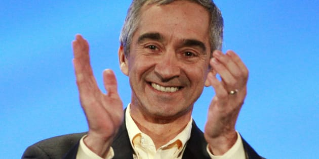 Patrick Pichette, chief financial officer of Google, claps after an announcement at in Kansas City, Kan., Wednesday, March 30, 2011. He announced Kansas City, Kansas as the Google 1-gig Fiber Winner. (AP Photo/Orlin Wagner)